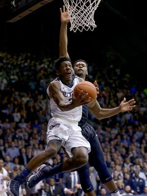 Butler Bulldogs guard Kamar Baldwin (3) lays in a basket around Villanova Wildcats forward Kris Jenkins (2) after he stole the ball with less then a minute to go in the second half of their game Wednesday, December 4, 2016, evening at Hinkle Fieldhouse. The Butler Bulldogs defeated the Villanova Wildcats 66-58.