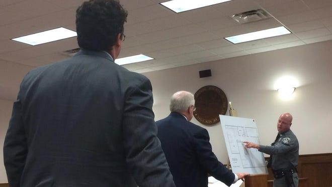Former Johnson City Police Officer Dave Castle, far right, explains Tuesday the layout of murder victim Patricia LaCaprara's apartment during the opening of Christopher Davis' trial.