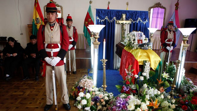 Soldiers stand around the coffin of Bolivian soldier Oscar Gironda during a wake at the military barracks in La Paz, Bolivia, Sunday.