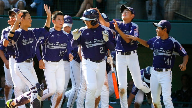 South Korea's Hae Chan Choi (21) celebrates with teammates after hitting a two-run home run off Chicago's Brandon Green in the sixth inning of the Little League World Series championship game.