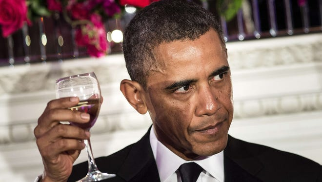 President Obama makes a toast during the 2014 Governors Dinner in the State Dining Room of the White House on Feb. 23.