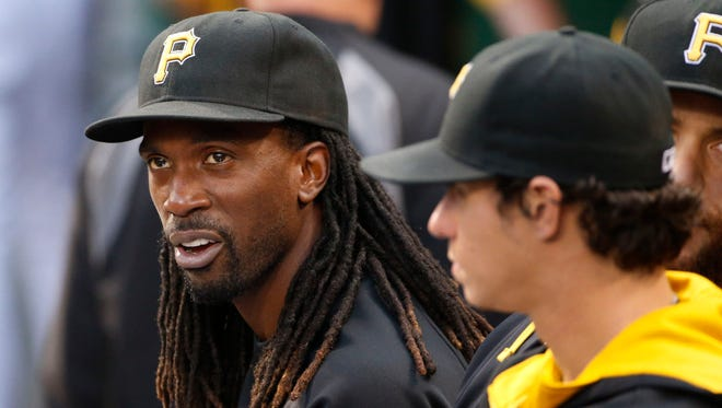 Pittsburgh's Andrew McCutchen, left, sits in the dugout next to Jeff Locke during the second inning against Miami in Pittsburgh on Tuesday. McCutchen is out with a rib injury.