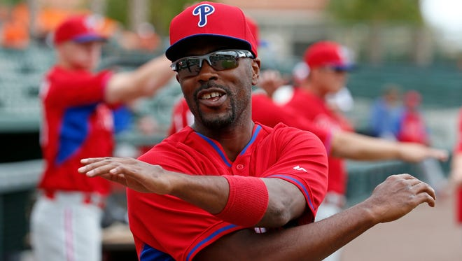 Philadelphia Phillies' Jimmy Rollins warms up before before an exhibition spring training baseball game against the Baltimore Orioles in Sarasota, Fla., Friday, March 7, 2014. (AP Photo/Gene J. Puskar)