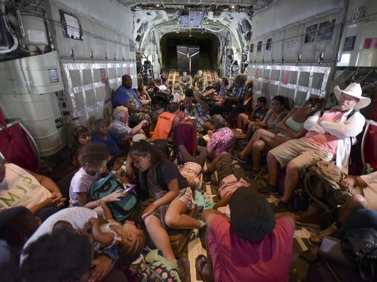 U.S. Air force personnel evacuate U.S. citizens from St. Martin, on Sept. 12.
