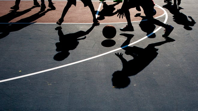 Teams face off during the Port Huron Basketball Academy Summer League at Knox Park in Port Huron.