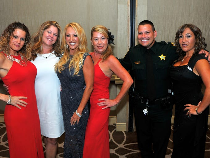 The Brevard Hispanic Center held their 2014 Viva Brevard Gala Saturday evening at the Hilton Rialto Place, with all proceeds going to the Brevard Hispanic Center.  Deputy Jeff Smith poses with Libina Bourgeois, Elaine Lathem, Laura Kutryb, Valerie Oliver and Yessenia Morrell.
