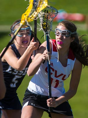 CVU's Annie Keen, right, is defended by Essex's Talia Boyers in Hinesburg on Tuesday, May 10, 2016.