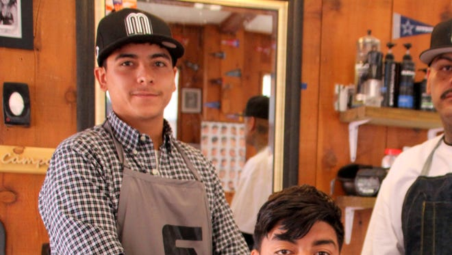 From left, Carlos Campos, Bryan Campos and John Hernandez have opened Los Barberos at 420 W. Spruce St. in hopes ot building clientele and providing haircuts and special grooming needs for the community.