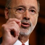 FILE - This Dec. 29, 2015, file photo shows Pennsylvania Gov. Tom Wolf speaking with members of the media at the state Capitol in Harrisburg, Pa. Pennsylvania government will set a modern state record for gridlock when Gov. Tom Wolf sends lawmakers a new spending plan even as they fight over the current budget. On Tuesday, Feb. 9, 2016,  the first-term Democrat will deliver an approximately $32 billion plan to the Republican-controlled Legislature. He'll need to break Republican resistance to a $1 billion-plus tax increase. (AP Photo/Matt Rourke, File)