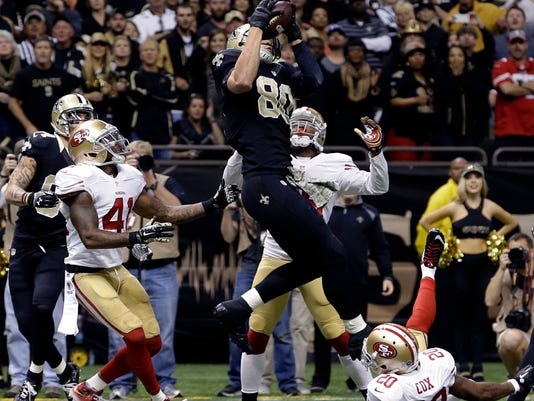New Orleans Saints tight end Jimmy Graham (80) pulls in an apparent touchdown reception at the end of regulation, but the play was negated by a pass-interference call on Graham, as San Francisco 49ers cornerback Perrish Cox (20) defends during the second half of an NFL football game in New Orleans, Sunday, Nov. 9, 2014. The play was the final of regulation, and the game went to overtime. (AP Photo/Jonathan Bachman)