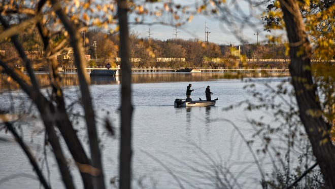 Fishermen try their luck Wednesday, Nov. 2 on the Mississippi River just above the Sartell dam. The National Park service has released its report on the health of the river.