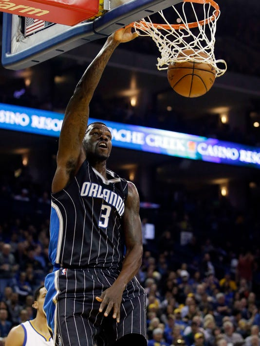 Orlando Magic's Dewayne Dedmon (3) dunks against the Golden State Warriors during the first half of an NBA basketball game Monday, March 7, 2016, in Oakland, Calif. (AP Photo/Marcio Jose Sanchez)