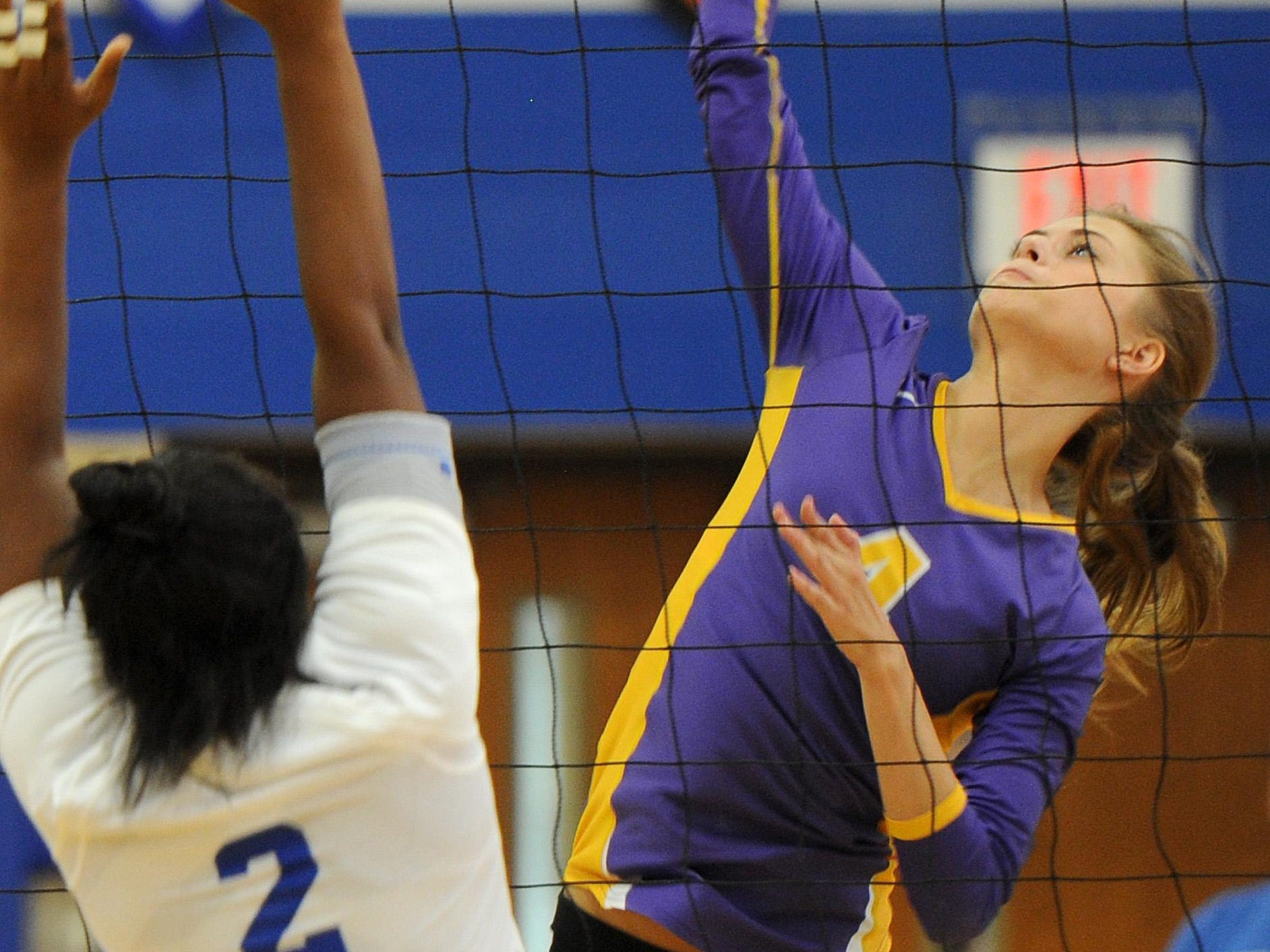 Unioto's Kassidey Winegardner spikes the ball across the net at Chillicothe during the game at Chillicothe Saturday, Aug. 28.