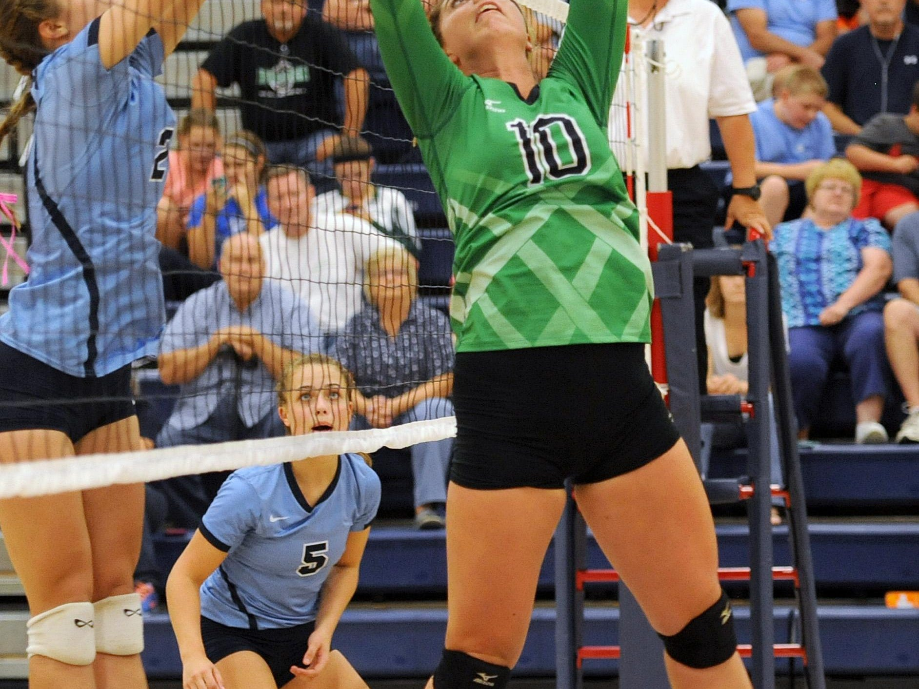 Huntington's Dylanna Gragg sets the volleyball up and over the net during the game against Adena High School at Adena on Tuesday. The final score was Adena 3, Huntington 0.