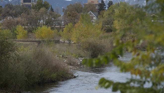 The Poudre River flows near Lincoln Avenue on Wednesday, October 11, 2017.