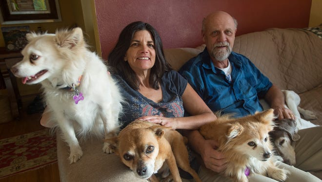 Dianne and Scott Skogerboe are pictured with their dogs at their home in west Fort Collins on Saturday, December 16, 2017. The couple, who also has five dogs, paid a veterinary bill for Olivia Roush and her dog Frodo after the dog was injured.