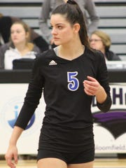 Junior setter Maddie Dowd helped get Marian's offense back on track with some strong setting.