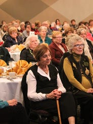 A full house listens to Francine Sagen speak Wednesday