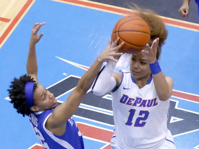 Kentucky guard Kastine Evans, left, fouls DePaul guard Brittany Hrynko during the first half of an NCAA college basketball game on Thursday, Dec. 12, 2013, in Chicago, Ill. (AP Photo/Charles Rex Arbogast)