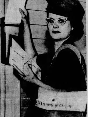 Florence Louise Ross, 37, delivers mail June 30, 1964, on her first day as Akron's first female letter carrier.