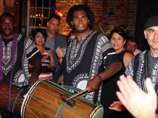 Members of the Global Education Center Drum Ensemble entertain guests at #TheLatinParty Saturday at Cannery Ballroom.