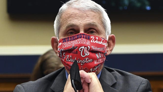 Director of the National Institute of Allergy and Infectious Diseases Dr. Anthony Fauci wears a face mask as he waits last  week to testify before a House Committee on Energy and Commerce.