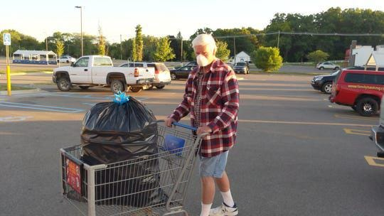 Loren Boyle of Waterford brings a large trash bag full of bottles and cans to the Kroger supermarket in White Lake early Monday, June 15, 2020.