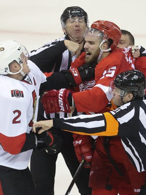 Red Wings forward Riley Sheahan fights with the Senators' Dion Phaneuf during the third period of the Wings' 5-1 win Monday at Joe Louis Arena.