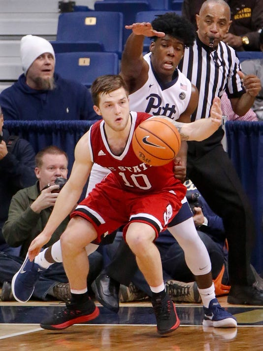 North Carolina State's Braxton Beverly (10) and Pittsburgh's Marcus Carr, top, try to get to the ball during the second half of an NCAA college basketball game, Wednesday, Jan. 24, 2018, in Pittsburgh. North Carolina State won 72-68. (AP Photo/Keith Srakocic)