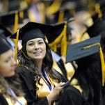 Graduates wait to receive their diploma during the Oak Grove High School graduation ceremony held at the Reed Green Coliseum Saturday.