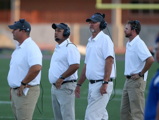Lake View's coaches (from left to right) Ben Lyons, Hector Guevara, Gerald Butts and Chad Kinney watch the field during the first quarter of Friday's season-opening football game at San Angelo Stadium on Sept. 1, 2017. All but Lyons were new to the coaching staff in 2017.