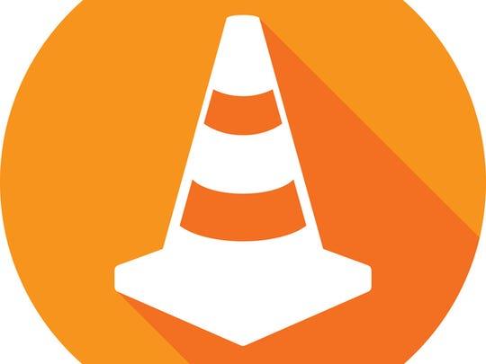 Vector illustration of an orange traffic cone icon
