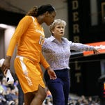 Tennessee head coach Holly Warlick talks with forward Bashaara Graves in the second half of an NCAA college basketball game against Vanderbilt Thursday, Feb. 11, 2016, in Nashville, Tenn. Tennessee won 69-51. (AP Photo/Mark Humphrey)