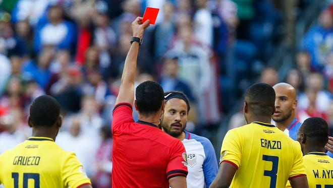 Referee Arbitro W. Roldan gives United States midfielder Jermaine Jones (13) a red card during the second half against Ecuador of quarter-final play in the 2016 Copa America Centenario soccer tournament at Century Link Field. The United States defeated Ecuador, 2-1.