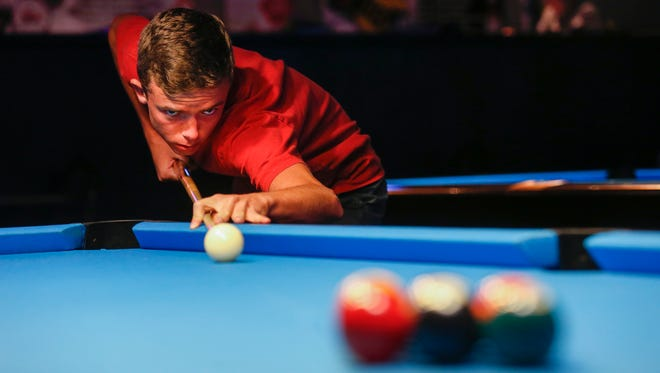 A top-ranked pool champion practiced at Billiards of Springfield in 2017 in this file photo. The 35-year-old pool hall announced it would close on Friday, May 29, 2020.
