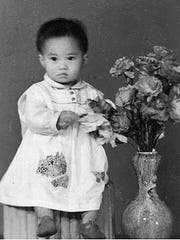 Mei-Mei is photographed in Canton, China in 1960. A