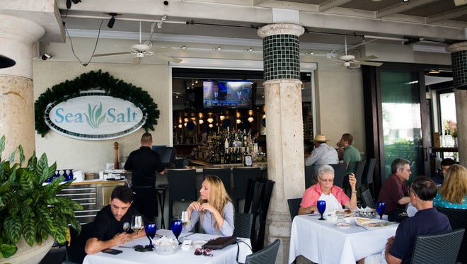 People enjoy a patio lunch at Sea Salt on Nov. 23, 2016, in downtown Naples. Dinner at Sea Salt with AC/DC bass guitarist Cliff Williams is one of the Naples Winter Wine Festival online lots.