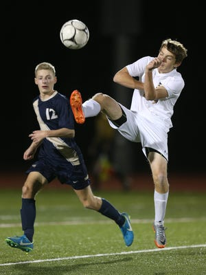 HFL's Gunnar Wetzel plays the ball away from Sutherland's Jake Petrone (12).