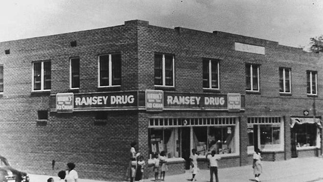 In this undated photo provided by the Greenwood Cultural Center, the Ramsey Drug Store, in an area once known as Black Wall Street, sits in Tulsa, Okla. The once-prosperous section of Tulsa that became the site of one of the worst race riots in American history is attempting to remake itself again after decades of neglect.