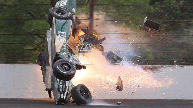 """Ed Carpenter of CHF Racing hit the wall and went airborne during the morning practice on Pole Day, May 17, 2015, for the Indianapolis 500. Carpenter, also a team owner, makes light of the subject of driver compensation. """"There's not really a place for me in the NFL, and I (stink) at hitting baseballs,"""" he said. """"So here I am. I would do this for free. It's what I love to do."""""""