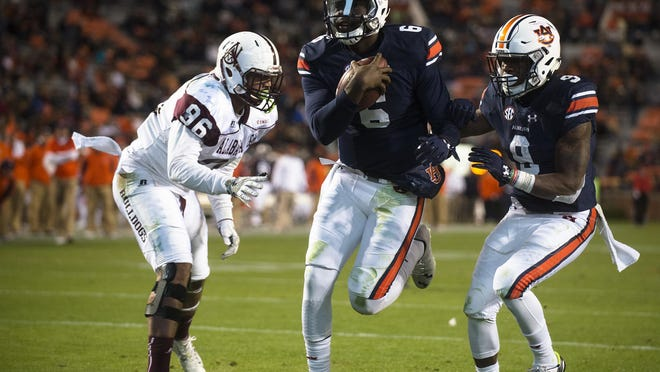 Auburn quarterback Jeremy Johnson (6) scores a Alabama A&M defensive lineman Zack Oglesby (96) attempts to stop him during the NCAA football game between Auburn vs. Alabama A&M Saturday, Nov. 19, 2016, in Auburn, Ala.