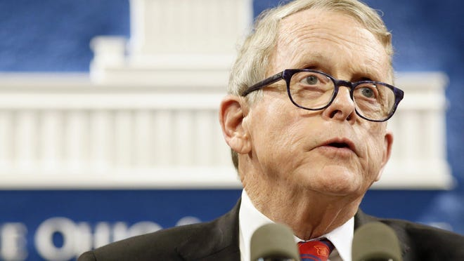 Gov. Mike DeWine speaks at a press conference about coronavirus at the Ohio Statehouse.