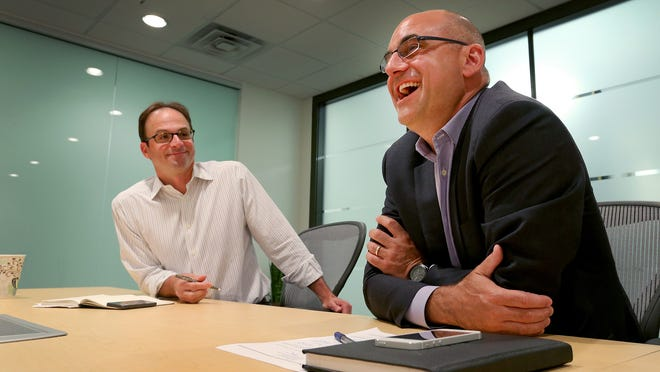 ExactTarget outgoing CEO Scott Dorsey,right, and incoming CEO Scott McCorkle,left,  at the company's headquarters on Monument Circle.  Matt Kryger / The Star