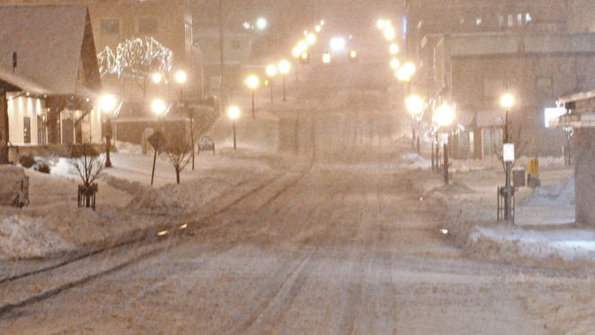Snow falls in downtown Marquette on Nov. 11.