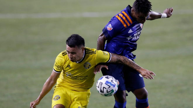 The Crew's Lucas Zelarayan, left, and FC Cincinnati's Joseph-Claude Gyau collide as they go for the ball during Saturday night's scoreless tie.