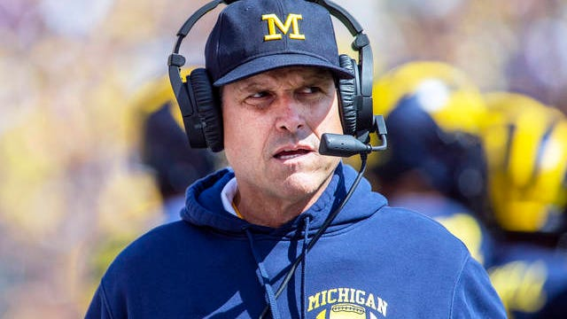 In this Sept. 7, 2019, file photo, Michigan head coach Jim Harbaugh is shown on the sidelines in the first half of an NCAA college football game against Army in Ann Arbor, Mich. Jim Harbaugh is pushing for a change that would allow football players to enter the NFL draft after their freshman or sophomore seasons in college. Harbaugh shared that idea among others in an open letter to the football community Thursday. Currently, players are not eligible for the NFL draft until they have been out of high school for at least three years.
