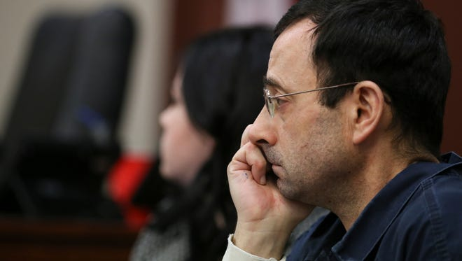Larry Nassar listens to victim impact statements on Tuesday, Jan. 16, 2018, during  the first day of testimony in Circuit Court Judge Rosemarie Aquilina's courtroom.
