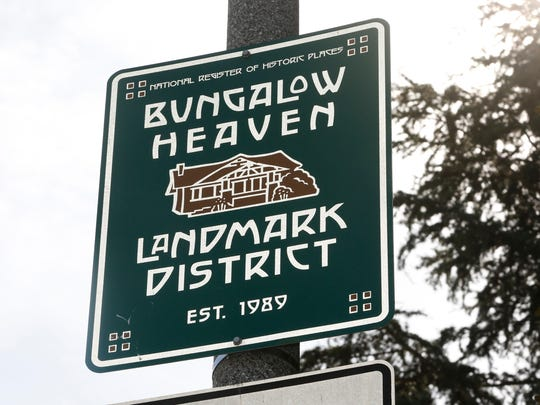 """This Feb 12, 2014 file photo shows a sign marking the """"Bungalow Heaven"""" district in Pasadena, Calif."""