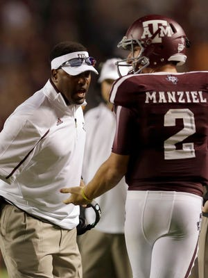 Texas A&M head coach Kevin Sumlin talks to quarterback Johnny Manziel (2) during the third quarter of an NCAA college football game against Sam Houston State.