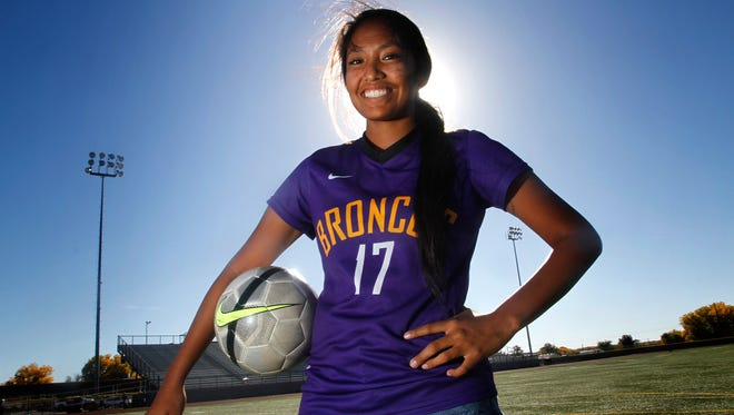 Kirtland Central's Nikki Begay poses for a portrait on Oct. 17 at Bronco Stadium in Kirtland.